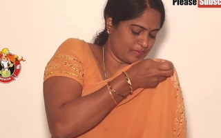 Mother debilitating a yellow saree, video