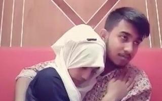 Bangladeshi girlfriend and boyfriend kissing in a restaurant