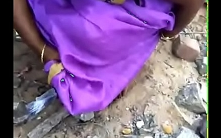 Tamil wife pee in the lead of husband in outdoor