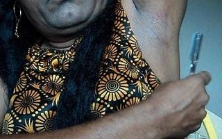 Indian girl shaving armpits hair by straight razor..AVI