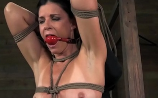 India Summer in rope harness ballgagged